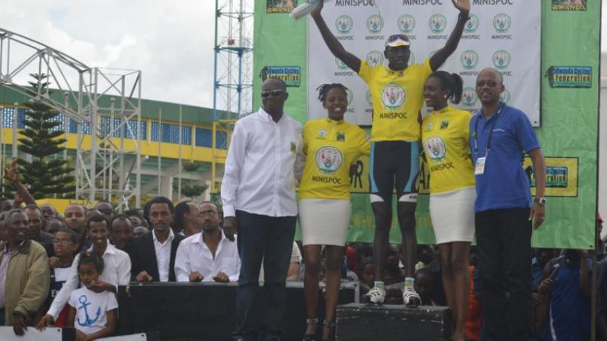 Ndayisenga after being crowned winner of  the sixth edition of Tour du Rwanda on Sunday. Left is Sports minister Joseph Habineza while , right, is cycling federation chief Aimable Bayingana. (Peter Kamasa)
