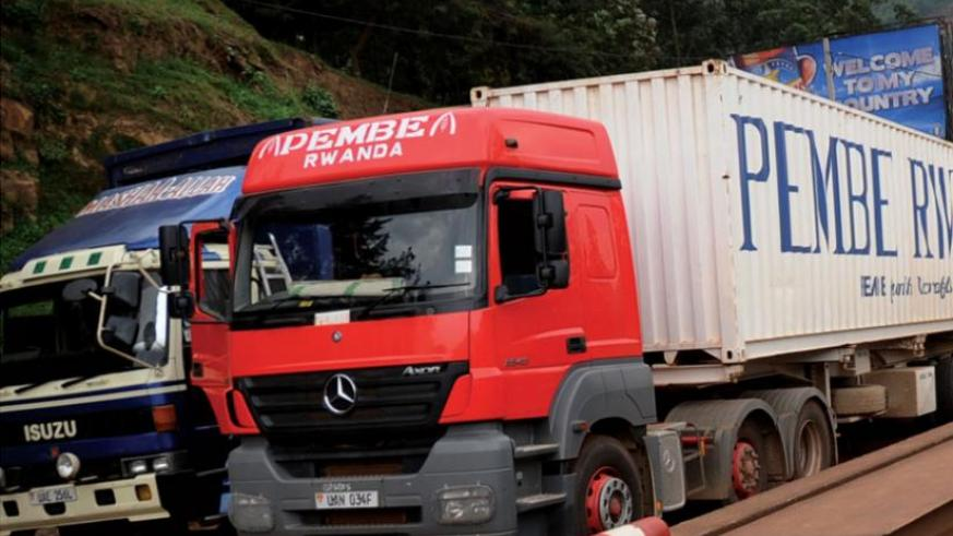 Ugandan-registered cargo trucks enter Rwanda at Gatuna border post. Local logistics industry players say they are being forced out of business by regional transporters; a situation that influenced the Cabinet decision to lift government ban on importation of RHD heavy trucks. File photo.