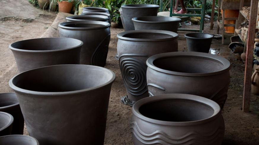 The pots are left to dry before being baked. (Timothy Kisambira)