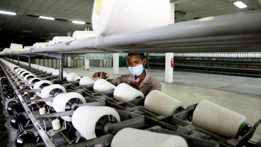 A worker at a textile factory in Kigali. Strategies are underway to reduce the import bill by increasing locally made products on domestic market. (File)