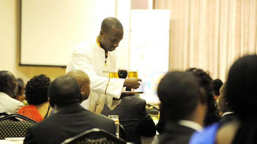 A waiter at a Kigali hotel serves guests; The forum will be an opportunity for stakeholders to tap into best practices from the region and beyond to grow their businesses. (File)