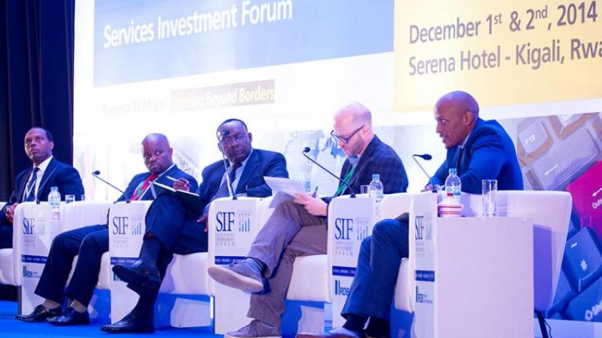 Penelist at the Service Investment Forum from L-R; RDB chief executive Francis Gatare, Youth and ICT minister Jean Philbert Nsengimana, Trade and Industry minister Francois Kanimba (moderator), David Primack, executive director of International Lawyers and Economists Against Poverty, and Konde Bugingo, chief executive of Rwanda Development Bank's commercial section yesterday. (Timothy Kisambira)