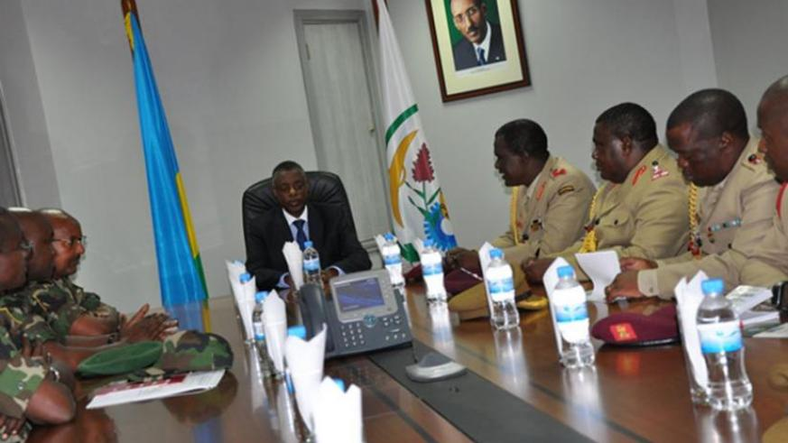 The Malawian delegation (R)  in a meeting with Defence minister James Kabarebe (C) and senior RDF officers at the Ministry of Defence headquarters in Kigali yesterday. (Timothy Kisambira)