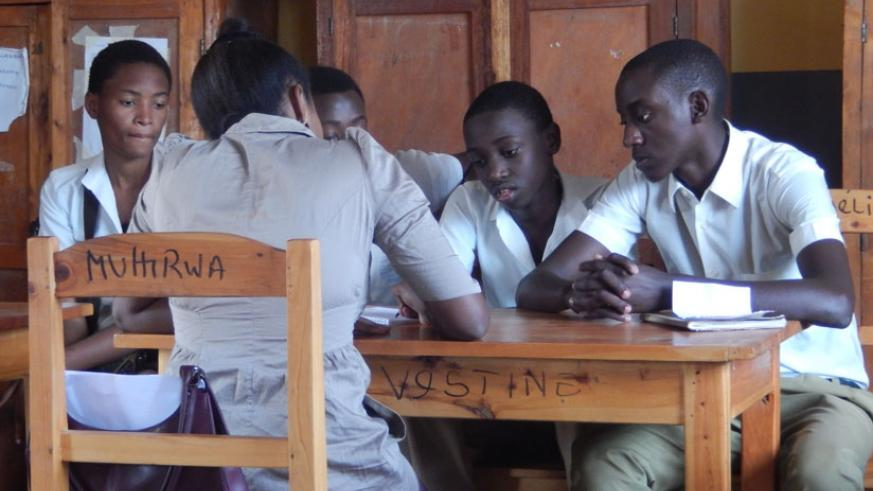 A teacher discusses with students some concepts. Whenever a student excels, the teacher shares in that joy. (Solomon Asaba)