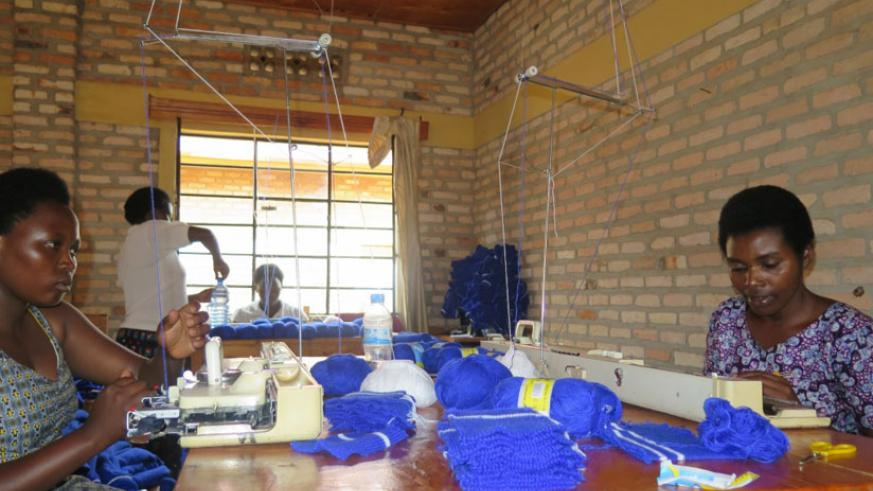 Uwimana knits clothes at a knitting workshop that operates at the association's head office. (Jean Pierre Bucyensenge)
