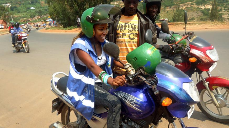 A female motorcyclist at work with her male counterparts in Kigali in 2012. (File)