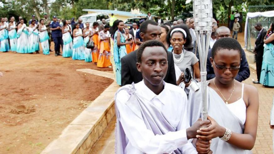 A procession of the Kwibuka Flame in Kicukiro District during the commemoration of the 20th anniversary of the 1994 Genocide against Tutsi earlier this year. (John Mbanda)