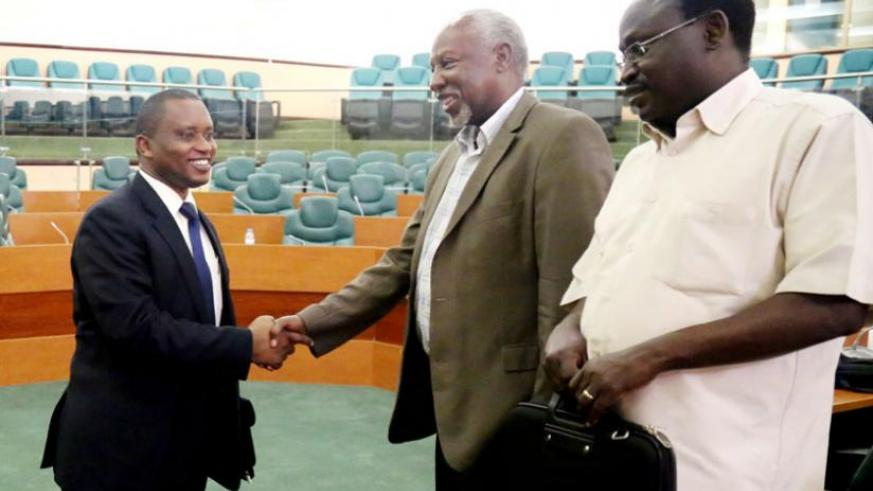 The Minister of State in charge of Primary and Secondary Education, Olivier Rwamukwaya (L), interacts with Senators Emanuel Bajyana (C) and Jean Népomuscène Sindikubwabo after a consultative meeting with senators in the senatorial Standing Committee on Social Affairs, Human Rights and Petitions in Parliament yesterday. (John Mbanda)