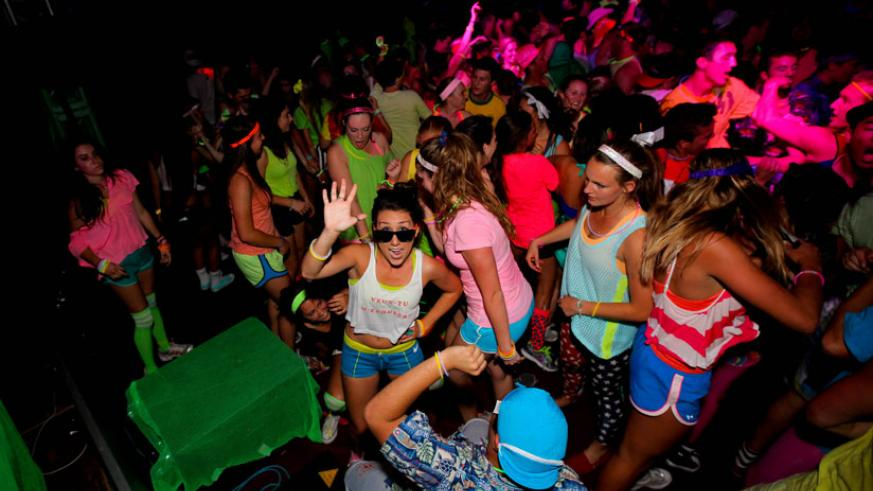 Students dance at a party. Some people have reservations about the dress code during holiday bashes. (Internet photo)