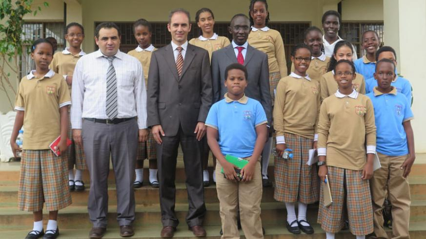 Pupils from Hope Academy Rwanda after meeting Chief Justice Prof. Sam Rugege (wearing red neck tie). Third from left is their headmaster Isa Gokturk Yilmaz flanked by his deputy Sefer Zengin (second left) and teacher Racheal Turigye (top right).