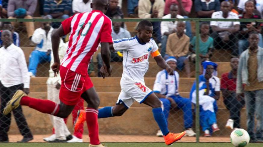Rayon Sports Captain Fuadi Ndayisenga goes past a Musanze defender in a league tie. The winger is back from injury. (Timothy Kisambira)