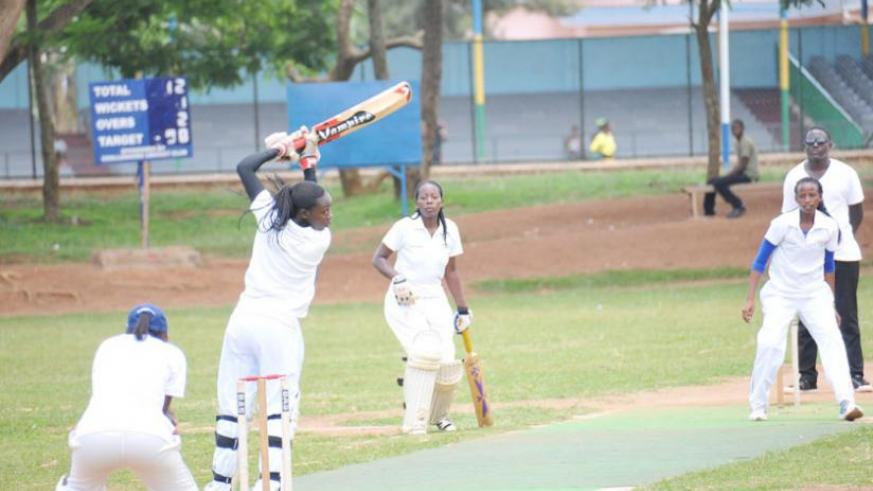 Betty Mukunzi (R), who plays for White Clouds CC, bowls against Queens of Victory captain Jeanne d'Arc Sibo (L) during a league game. (File)