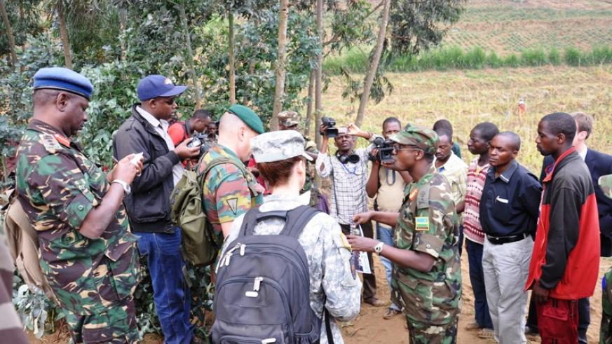 Members of the Expanded Joint Verification Mechanism team investigating shelling from the DRC in 2013.