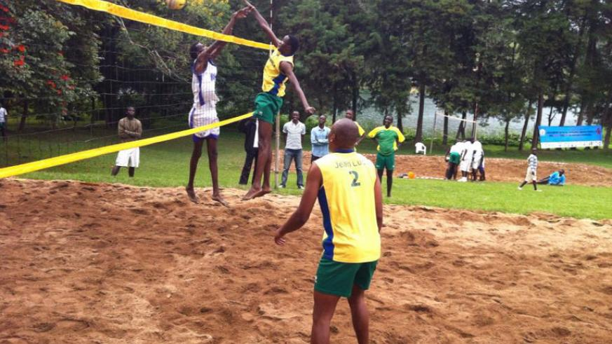 Flavien Ndamukunda spikes the ball during a beach volleyball game recently. The 25 year old is confident of winning the National Championship today. (Courtesy)