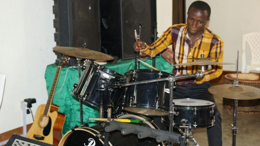 Musafiri doing what he does best, drumming. (Courtesy)
