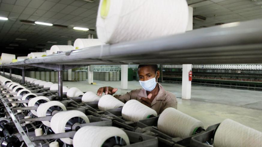 A worker at Texrwa Textiles. East Africa should promote industrial development as it fast-tracks the integration process to reap maximun benefits. (File)