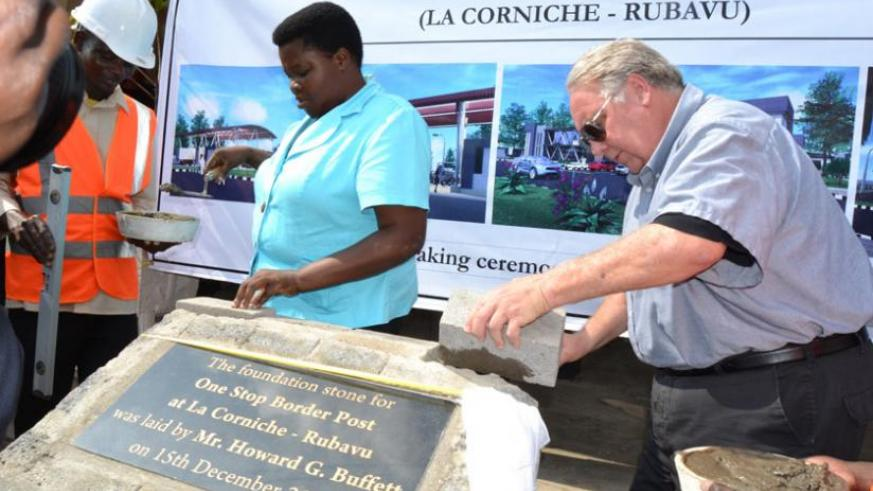 Howard Buffett (R) and Western Province governor Caritas Mukandasira lay a foundation stone where the one-stop border post will be constructed at 'Grande Barrière' between Rubavu and Goma. (Jean d'Amour Mbonyinshuti)