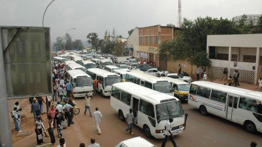 Passengers board omni-buses in Kigali recently.  (File)