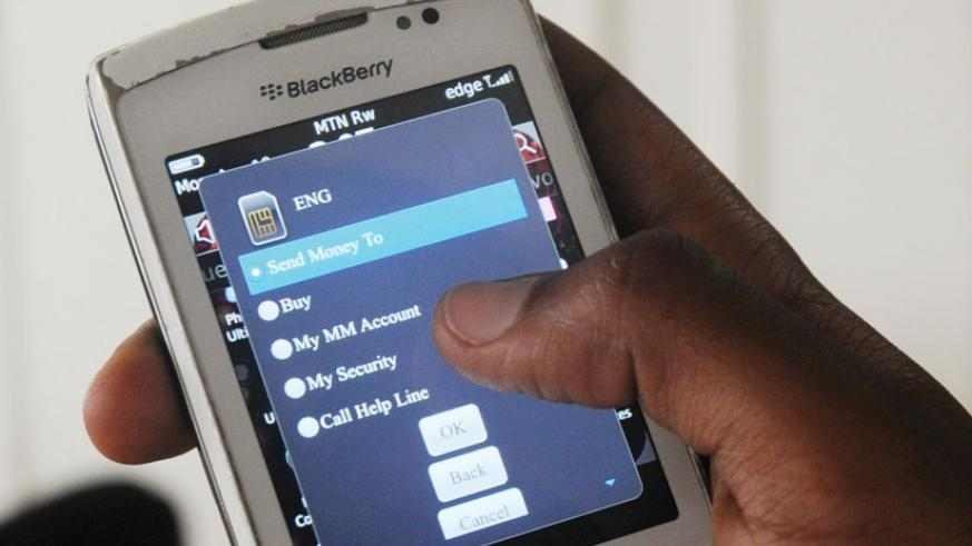 A mobile money service subscriber transacts business. The e-payment service is preferred by many people.