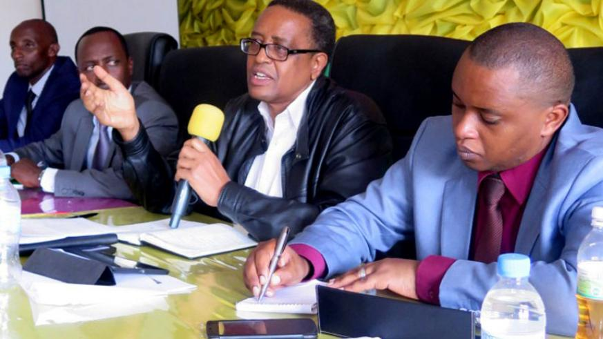 Education minister Prof.  Lwakabamba (with microphone) and Primary and Secondary Education state minister Olivier Rwamukwaya (R), at the meeting in Nyanza on Wednesday.  (Jean Pierre Bucyensenge)