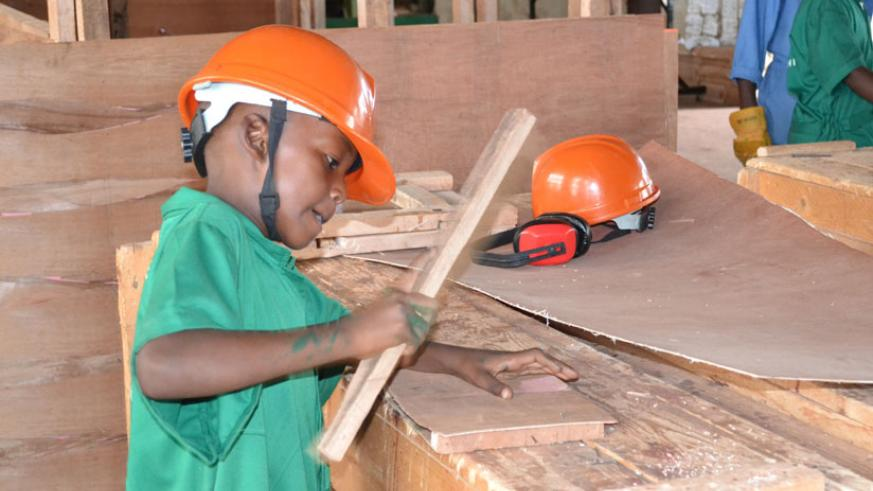 FUTURE CARPENTER: A 10-year-old boy doing his thing. (Stephen Rwembeho)