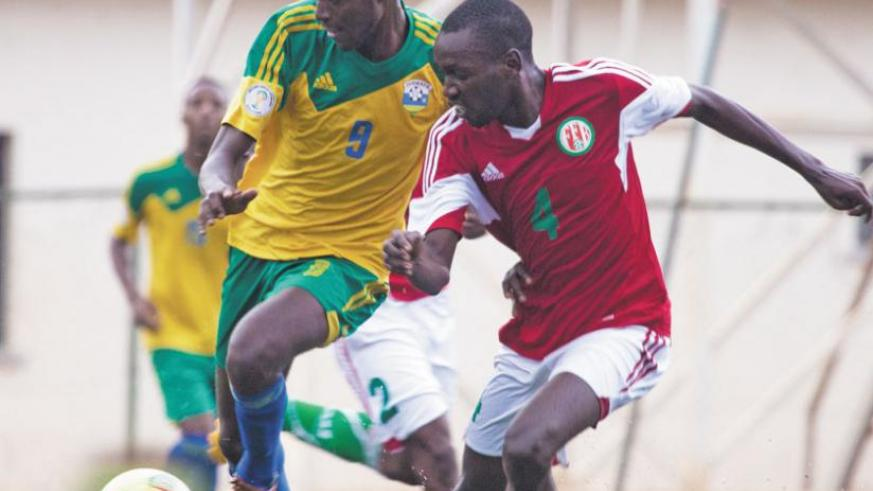 Young striker Bertrand Iradukunda, left, out-muscles a Burundian opponent during Saturday's international friendly match. (T. Kisambira)