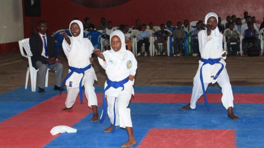 The female Kata team of Kagugu-based Flying Eagle Karate club competing in the Japan Ambassador Cup early this year. (Courtesy)