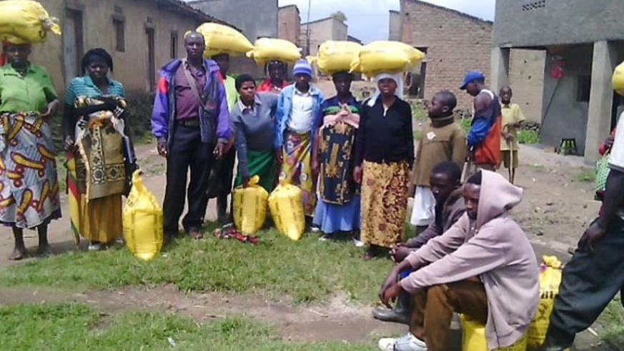 Residents of Nkotsi Sector in Musanze after sharing rice for the festive season. (Jean d'Amour Mbonyinshuti)