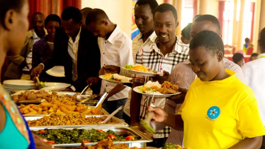 Some of the youth serve themselves a meal yesterday. (Timothy Kisambira)