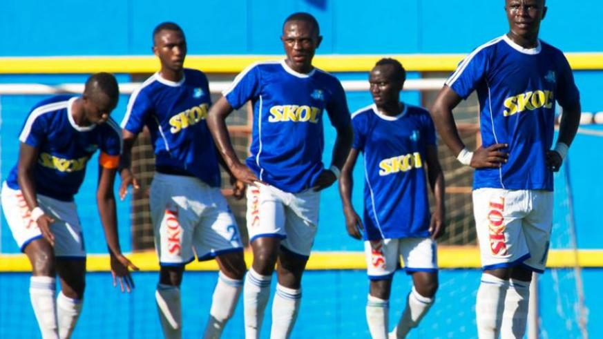 Rayon players look dejected following the loss to Police in the Ombudsman Cup this month. The club has not paid players for two months. (Timothy Kisambira)