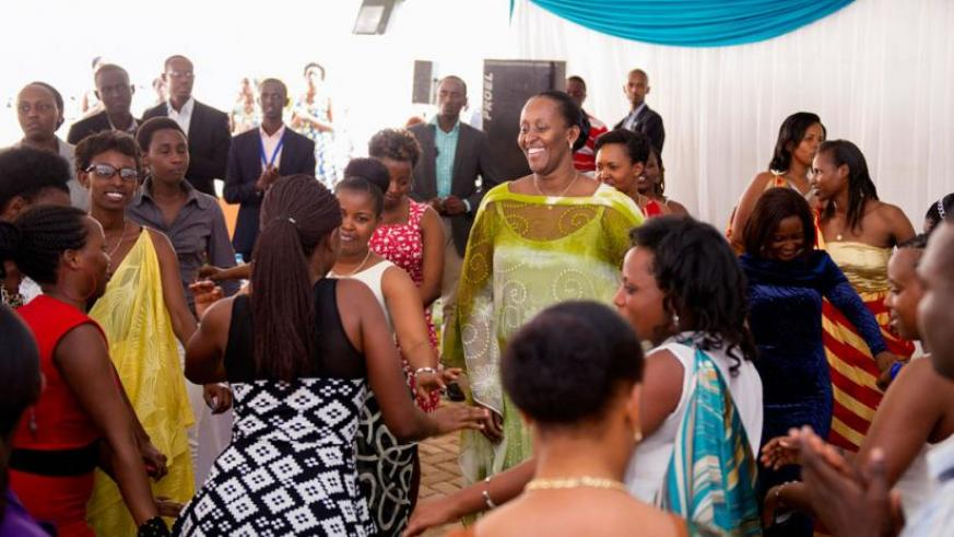 First Lady Jeannette Kagame, who on Sunday joined youths orphaned by the 1994 Genocide against the Tutsi for an End of Year party, at the One Dollar Campaign Complex in Kagugu, Kigali, dances with the youngsters.  The First Lady and other leaders pledged continued support to the survivors of the Genocide, which claimed at least a million lives. (File)