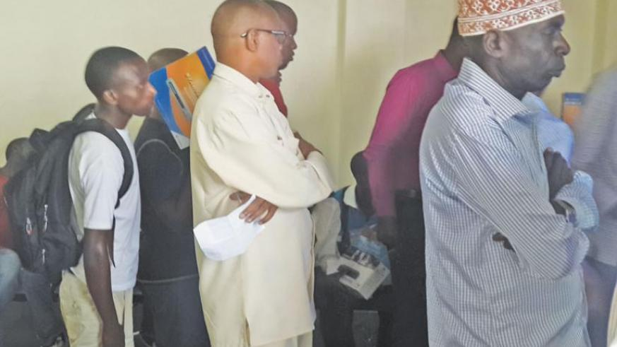 Customers queue to pay for decoders at StarTimes offices in Kimihurura. (Ben Gasore)