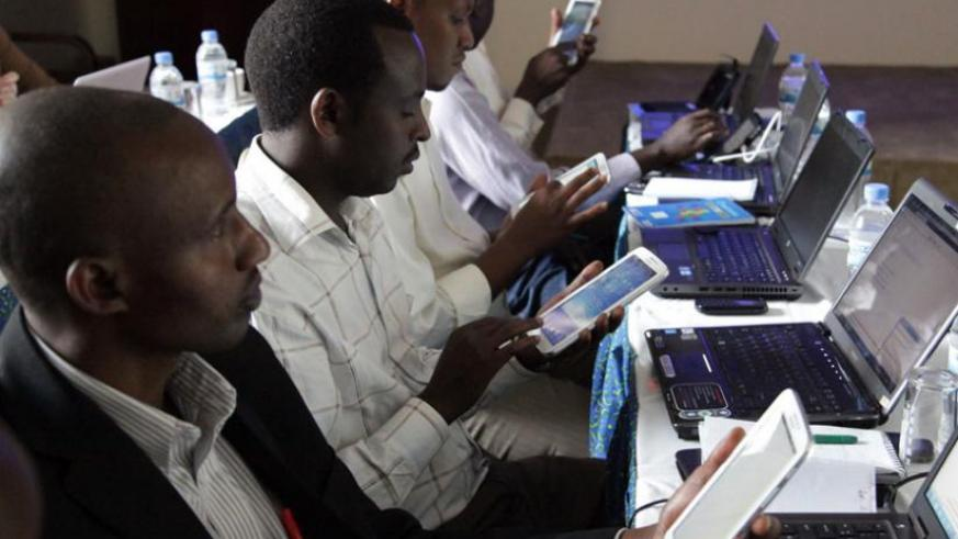 Participants at a workshop in Kigali browse the internet earlier this year. (File)