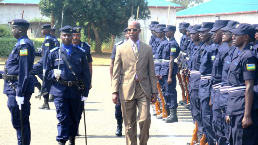 Harerimana inspects a Police parade at the ceremony in Rwamagana District yesterday. (Stephen  Rwembeho)