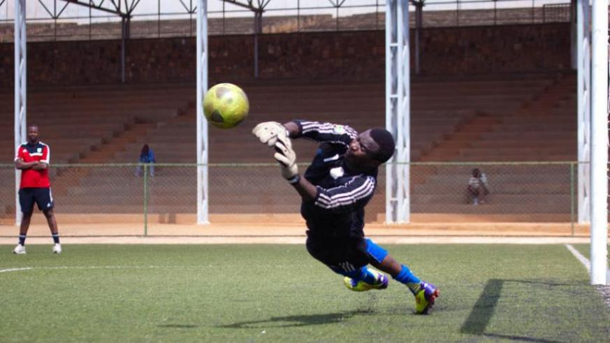Jean Claude Ndoli, seen here in training with the national team, has not played since injuring his right knee on July 20. (File)