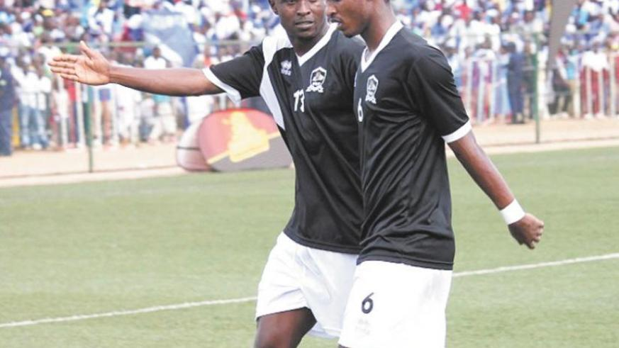 Yannick Mukunzi, right, who scored APR's first goal yesterday, listens to his captain Ismael Nshutiyamana during a previous league game.(File)