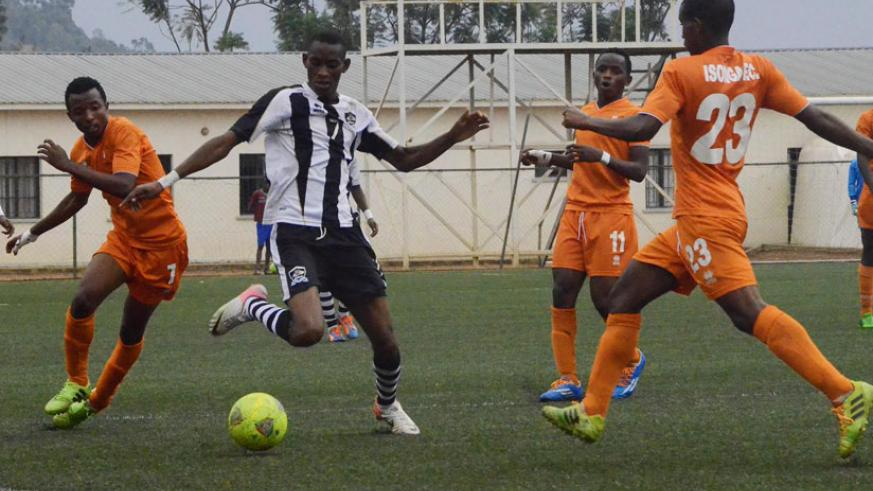 APR midfielder Jean Baptiste Mugiraneza tries to get past a host of Isonga defenders during a league game recently.  (Sam Ngendihimana)