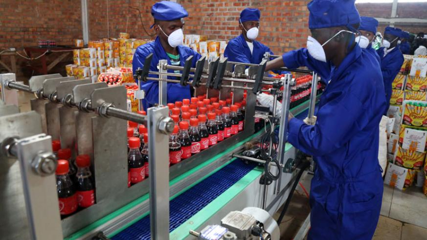 Crystal Bottling Company employees at work. (John Mbanda)