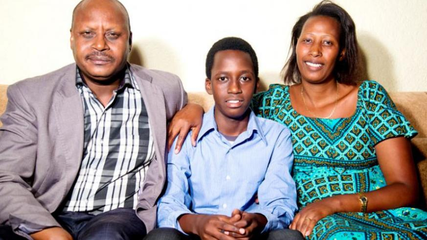 O-Level best student James Ishimwe with his parents at their home. (Timothy Kisambira)