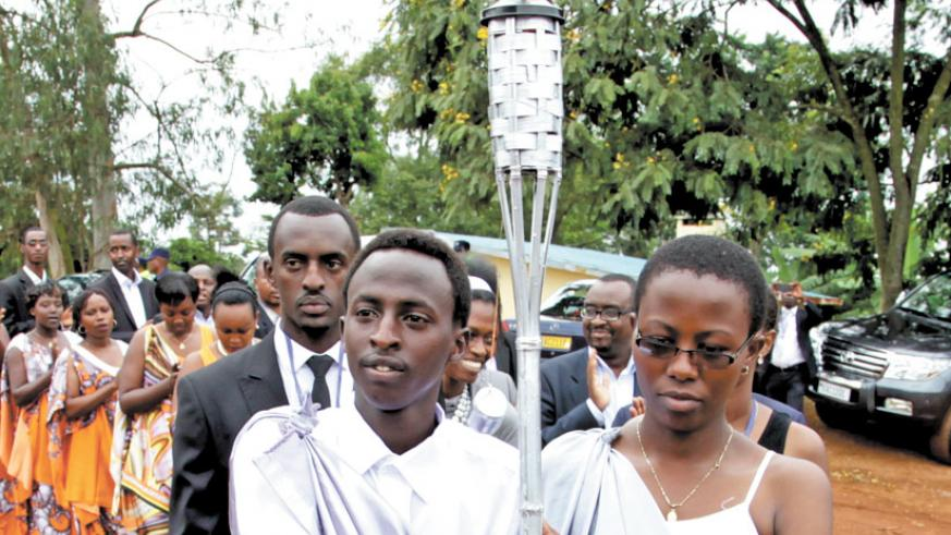 Youth carry the commemoration flame in Kicukiro District on its last leg of a countrywide tour last year.  (File)