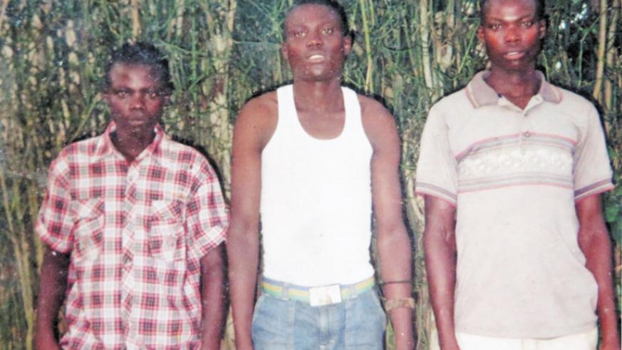 Ntahondi (right), the husband of Uwimana with his two younger brothers.