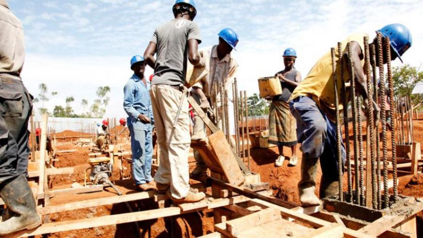 Workers at a construction site in Kigali in 2013. Authorities in Gasabo District have recalled construction permits issued between 2012 and 2014 over allegations of fraudulent issuance. (File)