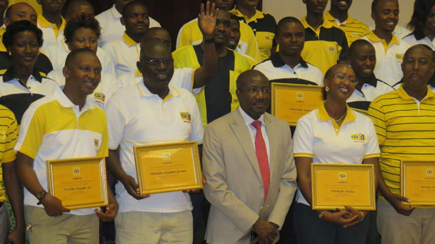 Some of the retailers pose for a picture with MTN chief executive officer Ebenezer Asante on Friday. (Ben Gasore)