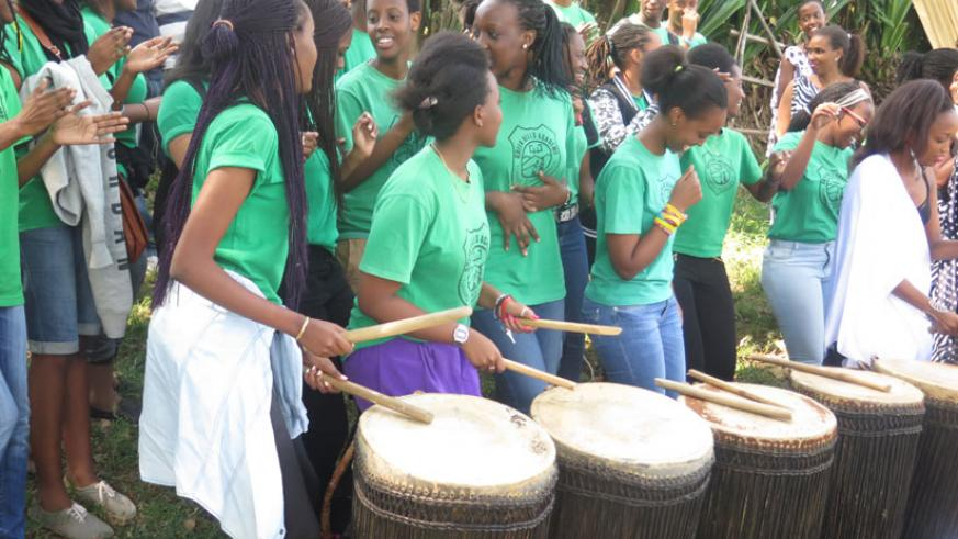 Students  of Green Hills Academy sound the royal drums at the site on Saturday.