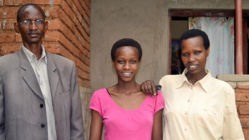Mugwaneza and her parents pose for a photo shortly after the interview. (Jean d'Amour Mbonyinshuti)