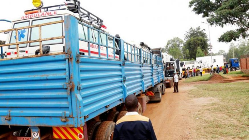 An ambulance and other equipment loaded on a truck at Kanombe Military Barracks prepare to depart for Central African Republic yesterday. (John Mbanda)
