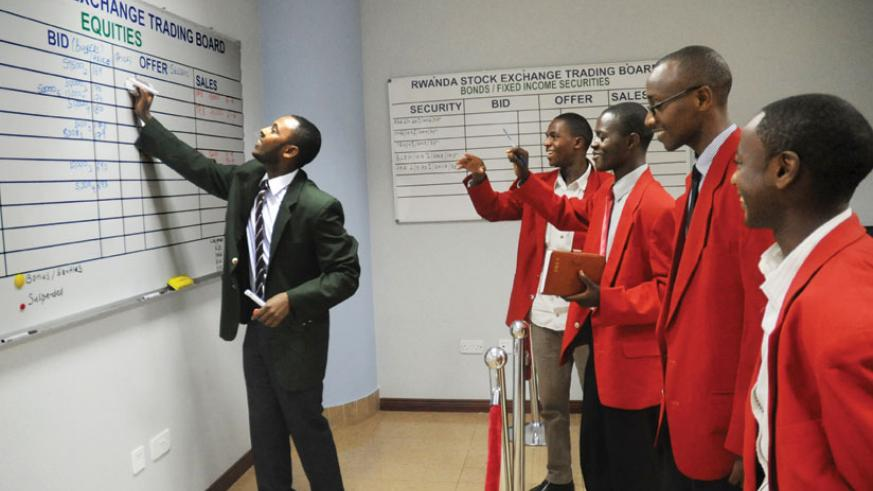 Stock brokers during a trading session at the local bourse. RSE performed poorly in 2014.