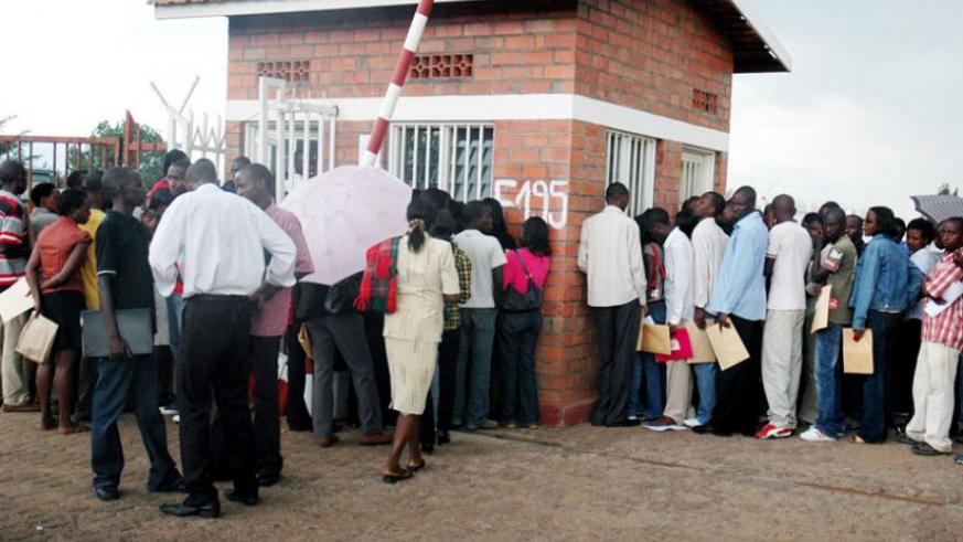 Job seekers queue to deposit their applications at a company reception in Kigali in 2009. (File)