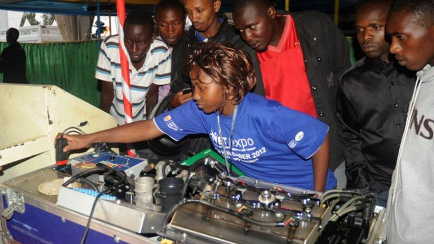 A student of mechanical engineering explains how an engine works during a TVET expo in Kigali in 2012. (File)