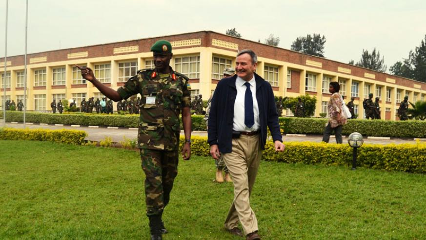 Brig. Gen. Charles Karamba, Commandant, RDF Command and Staff College, Nyakinama, takes Rtd. Lt. Gen. Eikenberry on a guided tour  of the college premises on Thursday. (Jean d'Amour Mbonyinshuti)